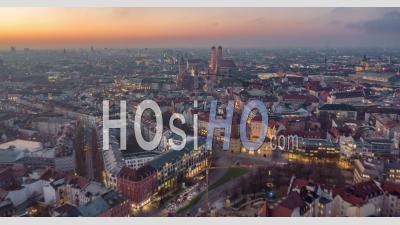 Beautiful Munich, Germany Establishing Shot Hyper Lapse Above City Center With Frauenkirche Cathedral And Marienplatz, Day To Night Time Lapse With Sunset And Big City Traffic - Video Drone Footage