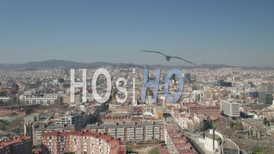 Aerial Barcelona Wide Drone Shot Of City Towards Center With La Sagrada Familia And Torre Glories, Torre Agbar 4k