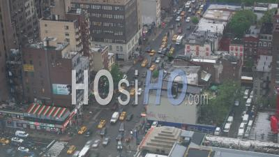 City Street Timelapse Of Car Traffic In The New York City Streets. Busy Multi Lane Traffic With Cars And Yellow Taxis On A Cloudy Day In New York