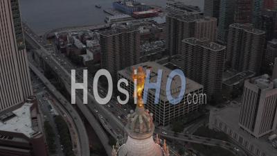 Aerial Close Up View Of Golden Civic Fame Statue On Top Of The Manhattan Municipal Building With Busy Car Traffic Towards Brooklyn Bridge Below 4k - Video Drone Footage