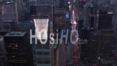 Close Up View Of New Manhattan Skyscraper With Times Square And City Lights Glowing In The Back, Beautiful 4k - Video Drone Footage