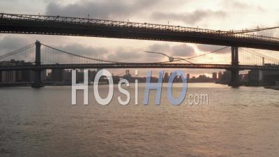 Flight Under Brooklyn Bridge At Sunrise In New York City In Beautiful 4k - Video Drone Footage