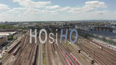 Aerial View Forward Flight Over Train Tracks On Beautiful Summer Day With Little Traffic Due To Coronavirus Covid 19 Pandemic - Video Drone Footage
