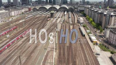 Aerial View Forward Flight Over Frankfurt Am Main, Germany Central Train Station Train Tracks On Beautiful Summer Day With Little Traffic Due To Coronavirus Covid 19 Pandemic - Video Drone Footage