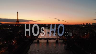 Aerail View By Drone At Sunset Of Eiffel Tower On Seine River Bridge Paris City Lights Reveal Shot During Autumn