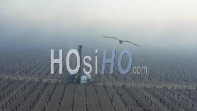 Aerial View, Anti-Frost Wind Machine In Bordeaux Vineyard During Sub-Zero Temperatures - Video Drone Footage