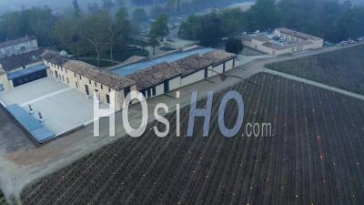 Aerial View Of Burning Candles At Chateau Figeac In The Bordeaux Vineyard During A Period Of Freezing - Video Drone Footage