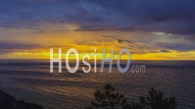 Dark Spring Sunset Over Ocean In Time Lapse