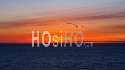 Vibrant Spring Sundown Over Dark Blue Ocean, Time Lapse