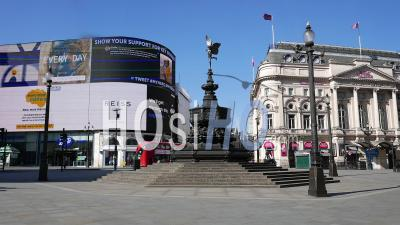 April 2020 First Lockdown Of Covid 19 Pandemic. Piccadilly Circus And Statue Of Eros London. All Retail Shops Closed And Empty Streets, Great Britain