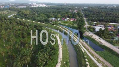 Aerial Fly Over River Near Malays Village With Plantation - Video Drone Footage
