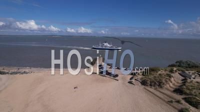Boat Near Pointe De Grave Between The Gironde Estuary And The Atlantic Ocean, France, Viewed From Drone