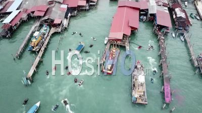 Aerial View Jet Ski And Goddess Of Sea Mazu Boat Arrive The Jetty. - Video Drone Footage