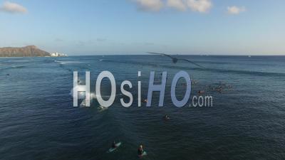 Surfers On Ocean, Waikiki, Honolulu, Hawaii - Drone Point Of View